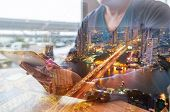 Double Exposure Of Man Or Male Hold Digital Wireless Tablet With City Building poster