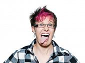 Portrait of a young expressive woman sticking out tongue in studio on white isolated background