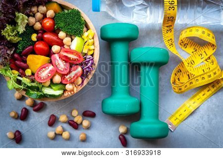 poster of Fresh Vegetable Salad And Healthy Food For Sport Equipment For Women Diet Slimming With Measure Tap