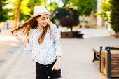 Emotional Girl Teenager In A Hat Walks Through The Summer City. Debonair Caucasian Girl Enjoying Pho poster