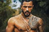 Brutal Handsome Man With Tattooed Body. Men Tattoo Casual Fashion. Portrait Of Brutal Handsome Male  poster