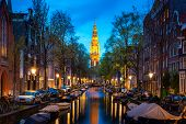 Canals Of Amsterdam At Night In Netherlands. Amsterdam Is The Capital And Most Populous City Of The  poster