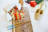 Noodles With Mushroom And Chicken In Take-out Box On Wooden Table. Stir Fry Noodle With Chicken In A poster