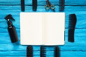 Hairdressing Handbook Or Guide Book With Blank Book And Different Hairdresser Work Tools On Blue Woo poster