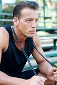 foto of bleachers  - portrait of a young athletic man with jump rope on bleachers - JPG