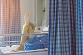 Elderly Male Patient Relaxing On Bed With His Legs Crossed In A Good Mood To Wait For The Time To Go poster