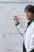 Young Handsome Biotech Student In Front Of Whiteboard
