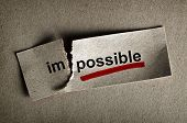 stock photo of motivation  - Word impossible transformed into possible - JPG