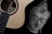 Spiritual Music. Traditional Meditating Buddha Statue With Acoustic Folk Guitar. Representing Music  poster