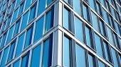 Modern Office Building With Reflection In Windows Of Building. New Office Building In The City Cente poster