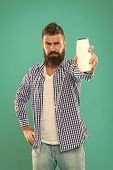 Test Beauty Product. Hair Conditioner Or Lotion. Man Bearded Hipster Hold Bottle Shampoo Or Shower G poster