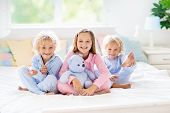 Kids Play In Bed. Children At Home. poster