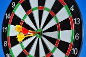 The Target For The Sport Of Darts And The Darts Hit The Target. Darts Game In Which Opponents Throw  poster