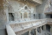 stock photo of ellora  - Facade of ancient rock carved Buddhist temple  - JPG