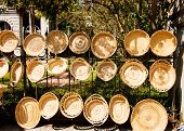 Handmade Baskets Hanging On A Fence