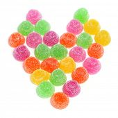 gumdrops of different colors forming a heart on a white background