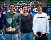 MELBOURNE - JANUARY 26: Nick Kyrgios (L)  poses with Pat Rafter and runner-up Thanasi Kokkinakis after winning the 2013 Australian Open Junior Boys Title on January 26, 2013 in Melbourne, Australia.