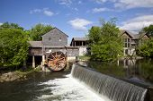 stock photo of water-mill  - The historic Old Mill in Pigeon Forge was built in 1830 and remains the premier attraction in this town in the Smoky Mountains - JPG