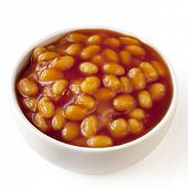 Baked beans in a white bowl, isolated on white background.
