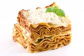 stock photo of lasagna  - Lasagna with Parmesan cheese and a basil branch - JPG