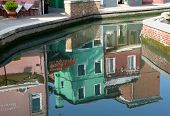 Mirroring At The Lagoon Of The Venetian Island Of Burano