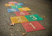 pic of hopscotch  - colorful vintage hopscotch game on a schoolyard - JPG