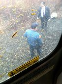 LITTLE FALLS, NJ - JAN 30: A policeman and conductor stand outside a NJ Transit train to NY on January 30, 2013 in Little Falls, NJ. The train collided with a truck carrying paint material.