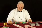 pic of poker hand  - Happy Casino dealer teaching students with cards - JPG