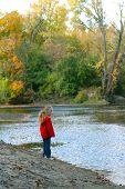 Girl On Riverbank