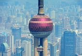 SHANGHAI, CHINA - MAY 28: Oriental Pearl Tower over river on May 28, 2012 in Shanghai, China. The tower was the tallest structure in China excluding Taiwan from 1994~2007 and the landmark of Shanghai.