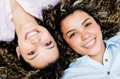 stock photo of bff  - Portrait of a couple of happy twin sisters smiling - JPG