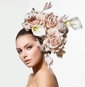 Fashion Beauty Model Woman with Flowers Hair. Bride. Perfect Creative Make up and Hair Style. Hairstyle. Bouquet of Beautiful Flowers.