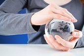Protecting The World - Hands Holding A Globe