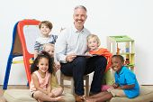 Pre School Teacher Reading Story To Children