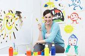 Teacher In Pre School Art Class
