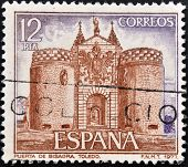 A stamp printed in Spain shows facade of Bisagra door on Toledo