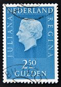 A stamp printed in the Netherlands showing a portrait of Queen Juliana