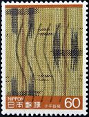 A stamp printed in Japan shows fragment of a fabric made on a loom