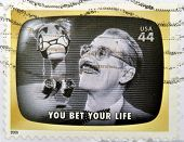 A stamp printed in USA Celebrates Classic TV shows Groucho Marx you bet your life
