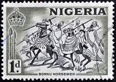 A stamp printed in Nigeria shows image of Bornu horsemen