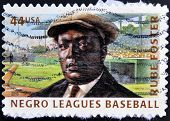 A stamp printed in USA dedicated to negro leagues baseball shows Rube Foster