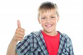 Boy In Trendy Clothes Showing Thumbs Up Sign