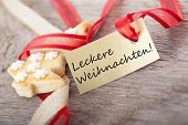 stock photo of weihnachten  - a golden banner with the german wirds Leckere Weihnachten which means delicious christmas - JPG