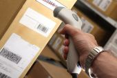 Man With Barcode Reader Works On Warehouse