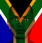 stock photo of superimpose  - South African flag superimposed upon mans face - JPG