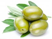 Green olives with leaves isolated on a white.