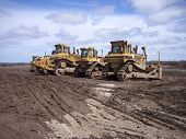 picture of earth-mover  - heavy construction equipment on excavation site - JPG