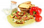 Sandwiches with vegetables and greens on plate isolated on white