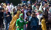 Children disguise oneself as film's character walking on street