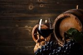 stock photo of grape  - Wine concept with glass grape fruit and barrel - JPG